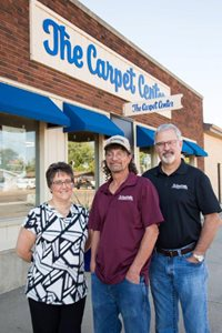 At The Front Of Store From Left To Right: Cheryl, Lance, and Gary
